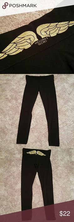 Victoria Secret Skinny Yoga Legging Gently used leggings that are too long for me at 5'7. They are a large regular but I'm convinced they were mislabeled and are meant to be long. Great for someone taller than me ! Black leggings with dark gold to light glitter ombred wings. So cute! Victoria's Secret Pants Leggings
