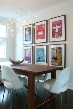 Frame your prints and hang them in a nice gallery wall like arrangement. Buy frames in one color and size at one source and framing everything at once will dress up that blank wall and give you a sense of accomplishment. -houzz-