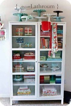 Table linens and cake stand cabinet