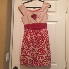 Floral Red Dress Lightly worn. Bow in middle needs to be re sewn. Easy fix. Other than that this dress is in great condition. Anthropologie Dresses Midi