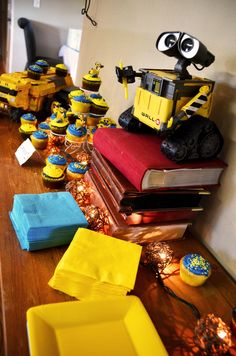 A Wall E Themed Birthday Tape Up Photos On Ribbon To Showcase The Last Year More Party Ideas