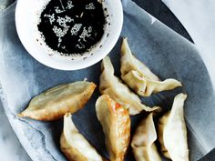 Crispy Gluten-Free Pork Potstickers with Sesame Dipping Sauce | Delicious and gluten-free, these crispy dumplings feature ground pork, sweet rice flour and a sesame dipping sauce.