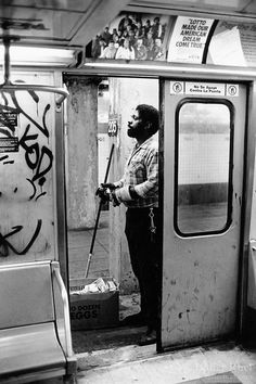 """New York City. Spanish Harlem. Tito works as a car cleaner in the subway at night. Tito lives below the poverty line and receives public assistance (AFDC, Home Relief, Supplemental Security Income and Medicaid). Advertisemnt for the lottery: Lotto made our amercian dream come true"""". Spanish Harlem, also known as El Barrio and East Harlem, is a low income neighborhood. Spanish Harlem is one of the largest predominantly Latino communities in New York City. 25.11.86 © 1986 Didier Ruef."""