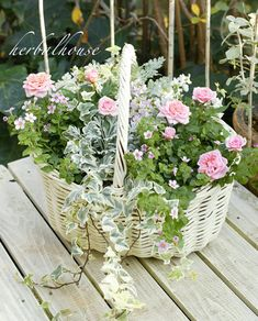 White wicker basket with soft pastel plants