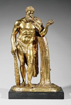 "A Continental Gilt Bronze Figure of Hercules Completing the ""Eleventh Labor: the Apples of Hesperides"", late 19th c., after the Antique, mounted on an agate base, overall height 24 1/2 in"