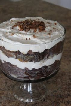 """I know everyone has a """"Better Than Sex Cake"""" recipe, but I need to share with you my perfected version. This one gets everyone to say """"MMMMMmmm THATS good. What you'll need: 1 Devils Food Cake mix, 1 large Cool Whip, 1 jar caramel (I prefer smuckers), 1 can sweet and condensed milk, and 5-6 skor bars/ heath bars chopped."""