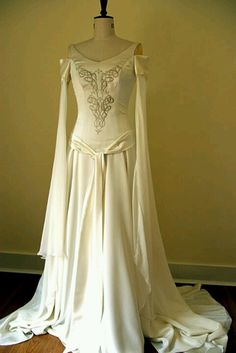 Someday, I would like a dress like this one.  Modest but flowy and with amazing elvish sleeves.
