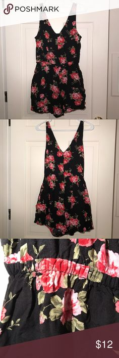 Adorable Floral Romper This romper is so so cute! Black with bright pink and red Floral detail. Little bow adds an extra feminine touch. Includes pockets! Very comfortable and breathable fabric. Perfect for sticky summer days. I would say it runs a little small for a large (width is fine but length from inseam to neckline is a little small) Fits more like a medium if you want to be safe. Forever 21 Dresses