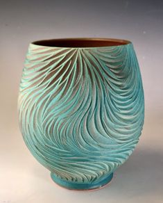 "Lovingly carved by Natalie's hand and beautifully glazed in shades of blue and merlot, this stunning open art vessel draws you in to get lost in its beauty. This vessel is 5.5"" in diameter and stands approximately 7.25"" tall. This a one of a kind piece so don't miss your opportunity to own it. Glazed in Natalie Blake Studios signature Teal and Merlot glazes. Please note the color may differ slightly from what is seen on your screen. This listing is for a single vessel."