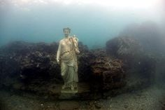 Underwater - The city of Baiae (also known as Campania) and the Portus Julius, home port of the western Imperial Fleet, Bay of Naples, Italy, a popular resort for the ultra wealthy in the last decades of the Roman Republic. It had a casino and a giant swimming pool, too.  Baiae was sacked by Muslim raiders in the 8th century, and was entirely deserted because of an epidemic of malaria around 1500. The most of the buildings are now under water, due to local volcanic activity.