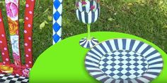 How amazing are these plates? Mark Montano, with Make Your Mark, has done another brilliant DIY project and what's really great is that he bought the plates at the Dollar Store...and, I'm sharing it with you today! I just love black and white stripes and checkerboards used in decor, with bright c
