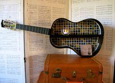 Repurposed angle-hung mosaic guitar shelf
