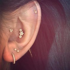 A beautiful diamond garland in this conch makes a beautiful focal point to this well #curatedear. The lobe has a diamond eternity ring matched with diamond studs - the trinity motif continued in the tragus with a diamond trinity stud. In the helix an adorable paisley stud. @paisleytunney #mariatash #libertyxmariatash #diamond #earcandy