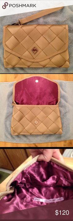 """Maggie Bags Discontinued Seatbelt Clutch Excellent condition. I don't believe this was even used. Perfect large clutch made of seat belts. Dimensions: 11.5"""" L, 7.5"""" H, 1"""" W Maggie Bags Bags Clutches & Wristlets"""