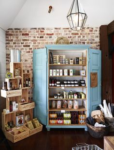 The wine boxes as shelves looks nice as does the armoire although both probably take up too much space for us.