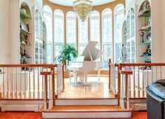 Dazzling white grand piano entryway