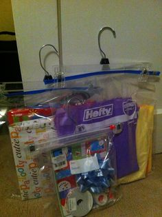 Finally figured out how to store my supply of labels, bows/ribbon, & tissue paper in an organized way!