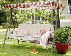Carve out a little slice of heaven for mom with a garden swing built for enjoying warm breezes.