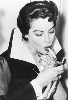 The great american actrees #AvaGadner lighting a #Cigarrette; in an old #Photo; When #SmokingTobacco was a #SocialDistinction in the 20th Century ...