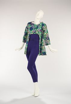 Wool evening ensemble (blue jumpsuit and floral-print coat) by Bonnie Cashin, American, 1955. This ensemble evokes the indefatigable hostess of the 1950s. The cutout of the coat front facilitates ease of movement while the jumpsuit allows for comfort in a time when the women's dress was commonly restricting.