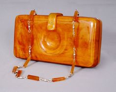 30s art deco bakelite clutch shoulder bag . Beautifully made with nice piano hinge to the back.