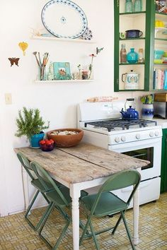 light wood table with mismatched chairs to me a good table is one you can read - Green Kitchen Table