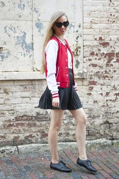 Lacy Rose in gets an A for style in a Deb Shops varsity jacket, skirt and oxfords.