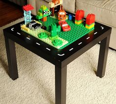 DIY duplo table-- Ikea LACK table with duplo board glued down. Add a tool or storage bench.
