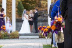 Shephard's hooks down aisle. Orange and purple fall wedding. Flowers by Angela Austin at #floraldesign #fallweddings #orangeandpurpleflowers www.floraldesign.me crystalmadsenphotography.com