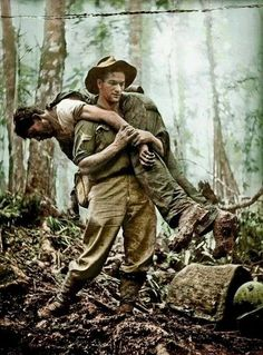 """Leslie """"Bull"""" Allen, Australian Infantry Battalion, carrying a wounded American solider to safety during the Wau-Salamaua campaign of World War II. He would go on to save another 11 American soldiers that day facing sniper, machine gun and mortar fire Anzac Soldiers, Vietnam War Photos, Vietnam History, Vietnam Vets, History Online, American Soldiers, Second World, Military History, Military Life"""