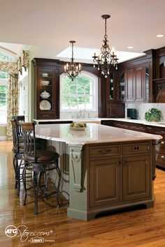 A kitchen is often the focal point of a home and this one stuns with style! The glistening chandeliers and detailed cabinetry radiate with class!