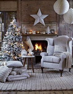 Christmas...sweater pillows, sweater chair, warm fire....warm, wonderful.  Love the white star above the mantle.