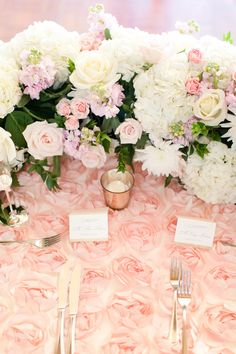 A gorgeous blush Arizona Biltmore Wedding. Pink velvet Mrs. Box!!! Stunning lace cathedral veil. Stunning blush chiffon bridesmaids dresses! A floral and white silk draped chuppah. Reception was dripping with flowers and pinks, a floral draped sweetheart table, and  a 5 story cake.