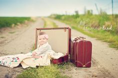 vintage luggage, grandma's quilt, dirt road next to alfalfa field and an adorable 9-month old baby equals happy photographer. Summerland Photography.
