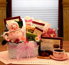 Invite someone special to brew away their day with this sweet, sophisticated tea gift set! They'll love the delicate rose stoneware teapot and matching cup with two varieties of rich, tea to savor. They'll love it – and you! Includes: White gloss basket, Stoneware rose teapot, rose tea cup with saucer, Chocolate truffle cookies, Raspberry chocolate cake, green tea, breakfast tea, butter toffee caramel corn, Chambery truffles, chocolate covered pretzels