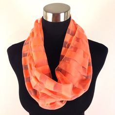 FREE W/ $25 PURCHASENWOT Fluoro Infinity Scarf NWOT Super cool fluorescent orange infinity scarf with sheer & orange stripes. Lightweight poly. 12x64 (32 doubled).  Accessories Scarves & Wraps