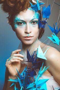 Photograph captured by La Fotografía by Alejandro Osma Sasha Louie between cranes by Erika Hurst (Graceincrease) and make up by Erika Valdez hair by Marissa Alvarez . . . #papercrane #origamicrane #origami #japaneseart #art #artist #model #modeling #photographer #photograph #makeup #hairart #hair #makeupartist #paperart #graceincrease #birds #bird #blue #iseecolor