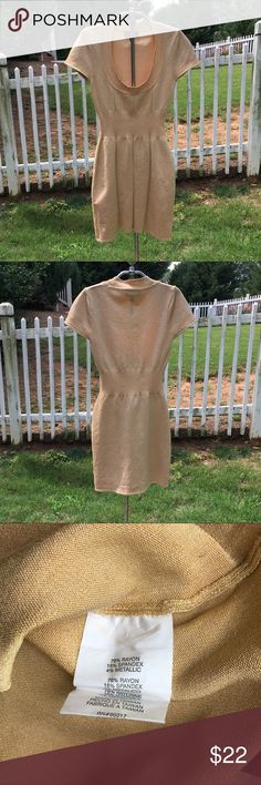 Bebe Bodycon Gold Metallic Dress Small Bebe Bodycon Gold Metallic Dress size Small. Rayon spandex blend to give this dress a great fit. Body on mini in gold metallic. Short sleeves. Wear it with some HIGH heels for a sexy night on the town. You will be turning heads in this fabulous dress. bebe Dresses Mini