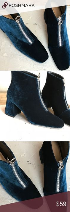 Zara Chunky Velvet high heel ankle boots with zip Zara Chunky , Velvet high heel ankle boots with zip. Block heel style booties. High heel ankle boots in navy blue velvet.  Featuring zip on the instep and silver hardware. please note, there is a mild stain created, I believe, due to manufacturing process. It's very mild and hard to see.  Last pic disclose it.  I have a pair and get so many compliments when I wear them. PAir with denim and oversized top for a chic trendy style. Zara Ankle…