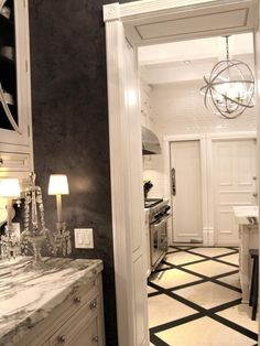 See a white traditional kitchen with a touch of glam at HGTV.com. A victorian lamp, marble inlay and ceiling-high subway add drama.