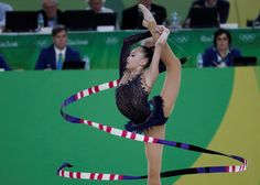 Kazakhstan's Sabina Ashirbayeva competes in the individual all-around qualifying event of the Rhythmic Gymnastics at the Olympic Arena during the Rio 2016 Olympic Games in Rio de Janeiro on August 19, 2016. / AFP / Thomas COEX