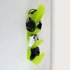 Wall mounted games controller and headset holder available in a large selection of colours. Neatly store and display your games controllers and gaming headsets with this wall mounted unit which will store them when not in use
