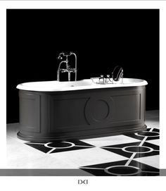 Devon&Devon's NEW Capitol tub!  A classical inspired prestigious freestanding bathtub, Capitol is characterized by it's rigorous and essential design. The external surface in aluminium is embellished with geometric decorations in relief. The internal tub is enameled cast iron, the surface is available in all of the 213 colours from the enamel collection Colors by Devon&Devon. Available at lavish-The Bath Gallery.