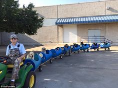 Dogs' best friend: Eugene Bostick, 80, a retired railroad worker from Texas, has built a special train out of fiberglass barrels mounted on wheels to take his nine rescued strays on bi-weekly rides