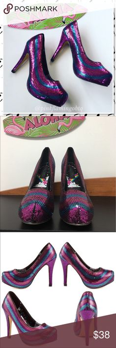 "⬇️$38Iron Fist Twinkle Toe Rainbow Sequin Platform Disco inspired fashion has never been so wearable with this style from Iron Fist. Twinkle Toes Platform features a multicolored sequin upper with purple, pink, and turquoise tones. This pump is complete with an almond shaped toe, 4 1/2"" heel and 1/2"" hidden platform. Man made upper and sole. Fits true to size. EUC only worn around the house, a tad to high of a heel for me. Iron Fist Shoes Heels"