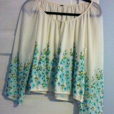 "Free People Peasant Blouse Never worn.  Ivory color with delicate embroidered blue/ green flowers.  Semi gathered at the waist.  Sleeves have been slightly hemmed to fit arms of a 5'3"" woman :) Free People Tops Blouses"