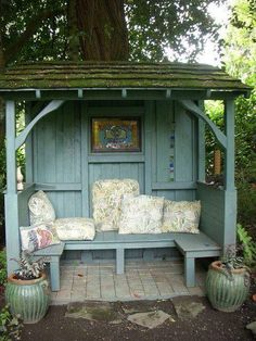 I'd make this little reading nook out of old doors, using four four-by-fours for the posts, and have the roof shingled... a beautiful little hiding spot in the far corner of our yard!