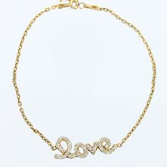 Yellow Gold Plated Sterling Silver 5″ Love Bracelet...  This cute little yellow gold-plated bracelet features the word 'love' in cursive letters, making a beautiful statement for a special girl or dainty woman. The bracelet is 5″ long with a 1″ extender.  Classic of New York – Style: T-6754  SKU: BR03283
