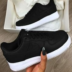 brand new d0733 e859b Nike Air Force 1 Trainers in Black and White. The 1982 phenomena that is  the Nike Air Force 1 touches down at Footasylum with the upper looking  resplendent ...