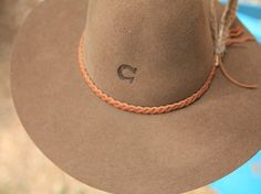 the wanderlust hat-available in brown & black!